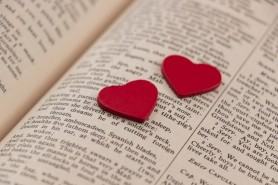 bigstock-hearts-on-a-book-page-57630812-1024x682